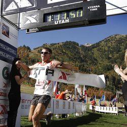 Max King, from Bend, Ore., wins the XTERRA Trail Running National Championship Half Marathon race  Sunday, Sept. 25, 2011, in Snowbasin, Utah.