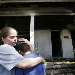 Connie Brown attempts to console her 10-year-old son, Levi, after he returned home from school in April and discovered their home had been destroyed by a fire, which also killed the family's dog. The family had no insurance on the home, located at 729 S. 500 East, and they have struggled to cope with the disaster.