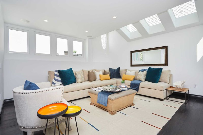 Couch with skylights and clerestory windows overhead