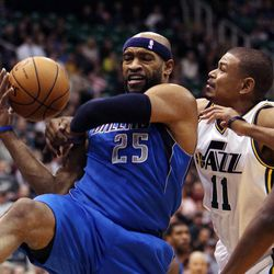 Vince Carter of the Dallas Mavericks is fouled by Earl Watson of the Utah Jazz during NBA basketball in Salt Lake City, Monday, Jan. 7, 2013.