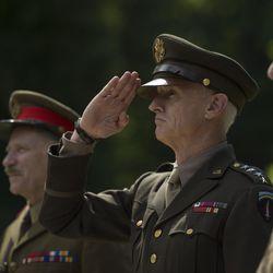 "Danny Webb as Field Marshal Alan Brooke, left, John Slattery as Gen. Dwight D. Eisenhower, center, and Julian Wadham as Gen. Bernard Montgomery, right, in ""Churchill."""
