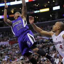 Sacramento Kings guard Isaiah Thomas, left, puts up a shot as Los Angeles Clippers guard Randy Foye defends during the first half of their NBA basketball game, Saturday, April 7, 2012, in Los Angeles.