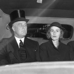 President Roosevelt in his car with two guests at Union Station going to the Tabernacle for former Governor George H. Dern's funeral, in September 1936.