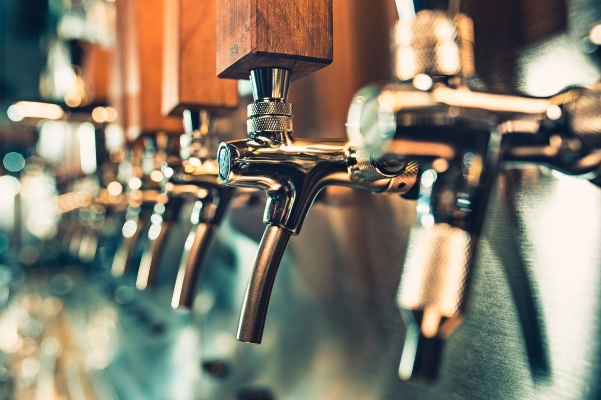 The beer taps in a pub.