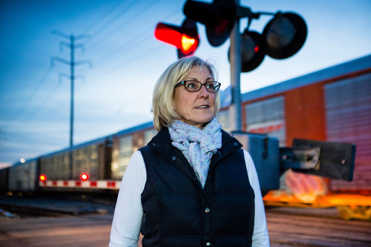 Betsy Buckley at the railroad crossing in west suburban La Grange where she helped two women and two children get out of a car that was stalled on the tracks, just before a train crashed into it Tuesday.