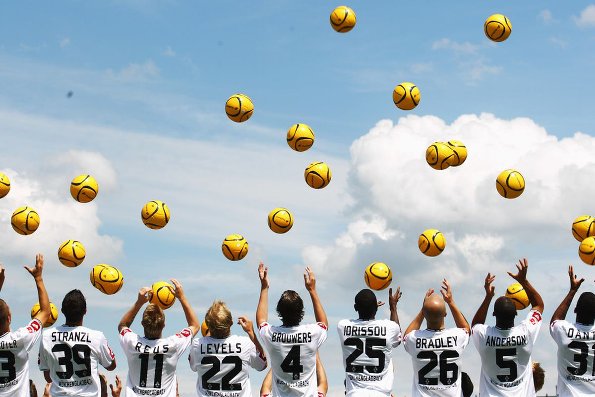 MOENCHENGLADBACH, GERMANY - JULY 07:  Player of Borussia M'gladbach throw balls in the air during the Borussia M'gladbach team presentation at Borussia Park on July 7, 2011 in Moenchengladbach, Germany.  (Photo by Joern Pollex/Bongarts/Getty Images)