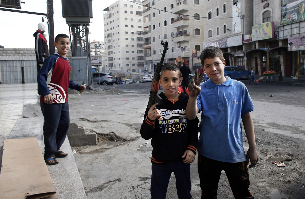 Palestinian boys toy gun