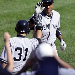 New York Yankees' Curtis Granderson, right, celebrates his home run with teammate Ichiro Suzuki (31), of Japan, during the sixth inning of a baseball game against the Baltimore Orioles, Sunday, Sept. 9, 2012, in Baltimore. The Yankees won 13-3.