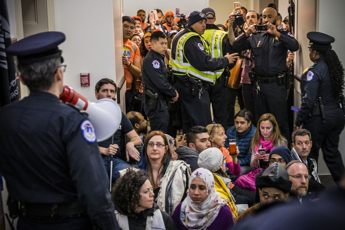 Pro DACA and Dreamer supporters try to get an office visit with Paul Ryan outside his office at the US Capital on March 5, 2018 in Washington, DC.