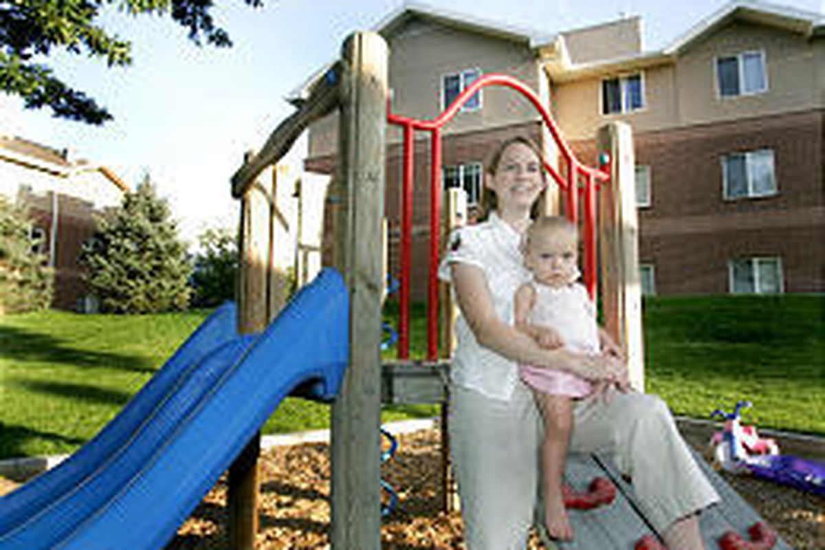 Bethany Baynes and her baby daughter, Abby, use the playground area Thursday at BYU's Wyview Park.