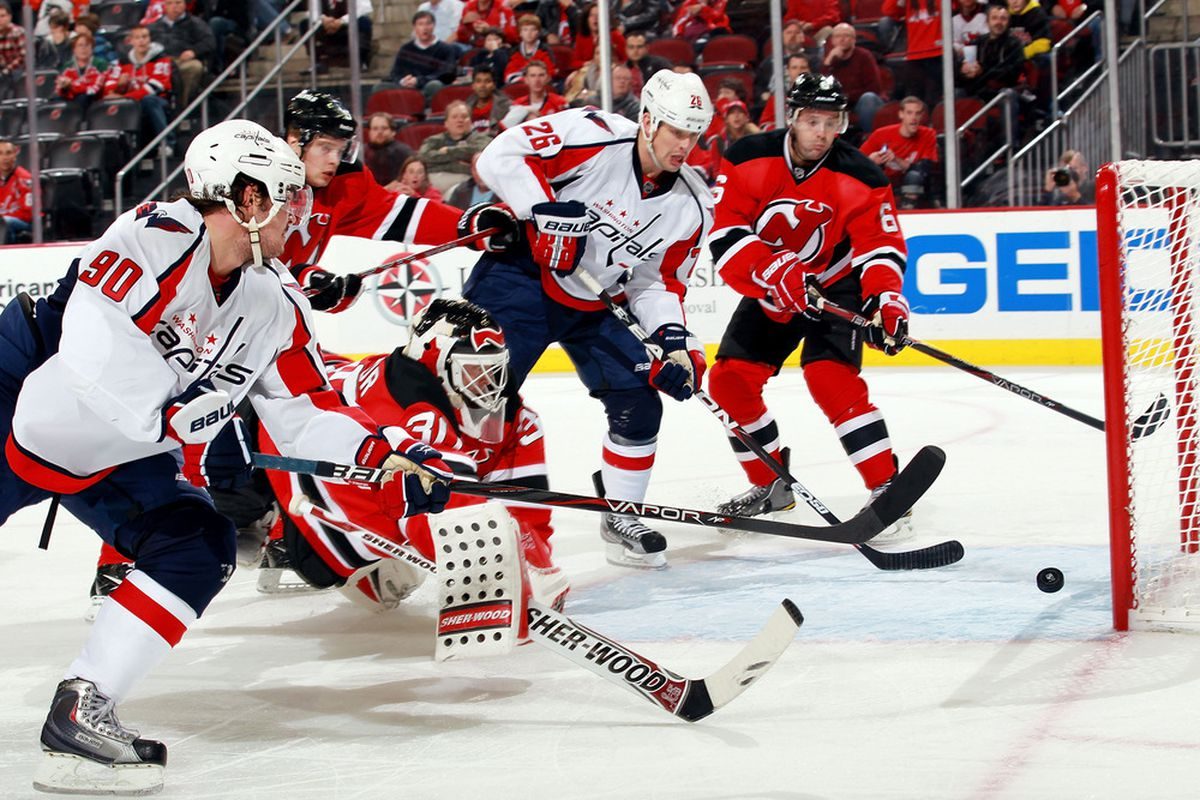 """When this happened, I immediately thought """"The Devils aren't coming back from this."""" Also: Johansson (#90) wasn't covered on this sequence of events.  Ugh. (Photo by Nick Laham/Getty Images)"""