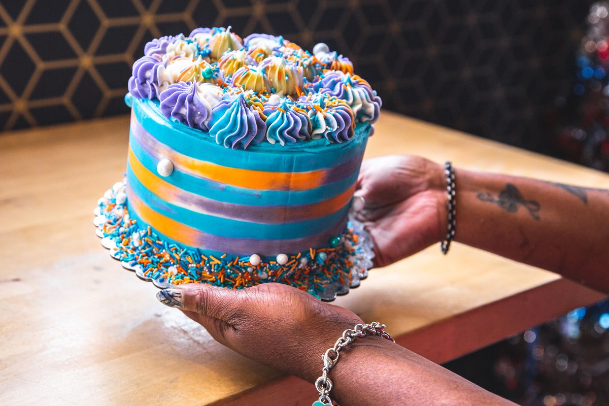 A colorful cake with frosting.