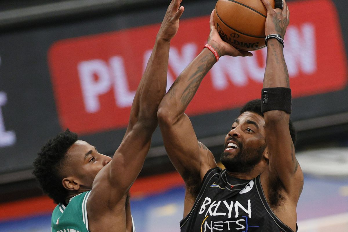 Kyrie Irving #11 of the Brooklyn Nets shoots as Aaron Nesmith #26 of the Boston Celtics defends during the second half of Game Two of their Eastern Conference first-round playoff series at Barclays Center on May 25, 2021 in the Brooklyn borough of New York City.