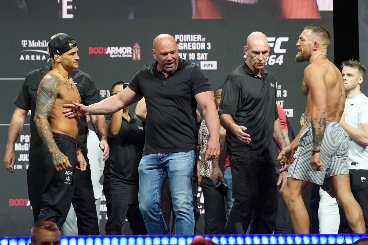 Dustin Diamond Poirier (and Conor Notorious McGregor face off in front of a packed house at the UFC 264 ceremonial weigh-in at T-Mobile Arena on July 9, 2021 in Las Vegas, NV, United States.