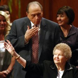 President Thomas S. Monson sends his wife Frances a kiss while leaving the General Relief Society Meeting at the Conference Center on Temple Square in Salt Lake City on Saturday, Sept. 29, 2012.