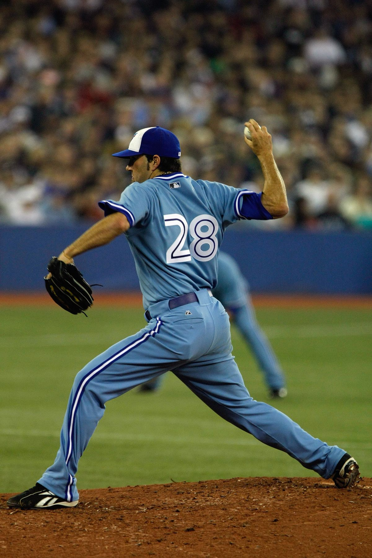 Shaun Marcum's #28 is in focus here as he delivers a pitch in 2008.