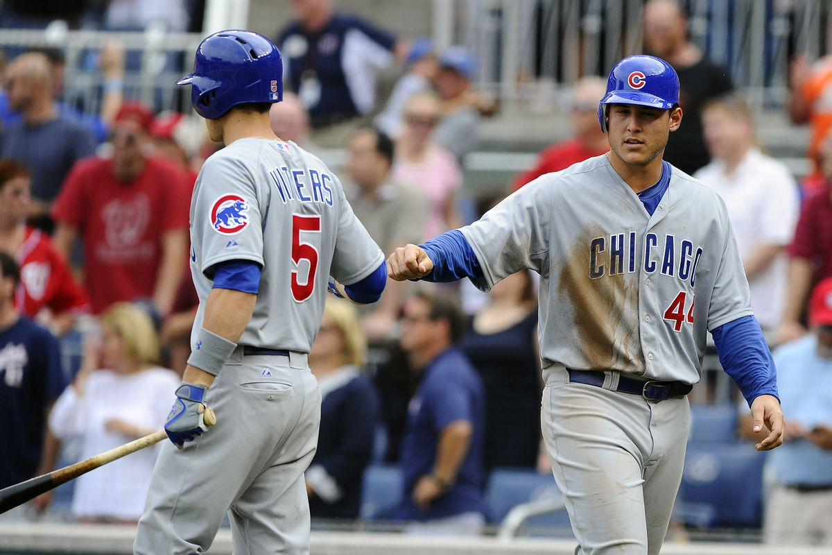 Washington, DC, USA; Chicago Cubs first baseman Anthony Rizzo is congratulated by Josh Vitter after scoring a run against the Washington Nationals at Nationals Park. The Nationals defeated the Cubs 2-1. Credit: Brad Mills-US PRESSWIRE