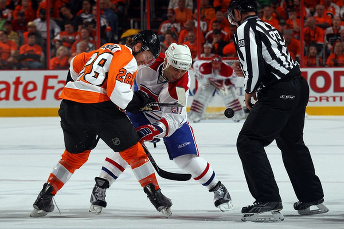 Claude Giroux, Scott Gomez and Jaroslav Halak all focused on the puck.  Two of those guys may have forgotten their contacts in this one.