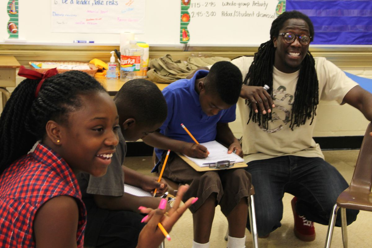 Freedom School teacher Lozie Guy (right) walks his class through an exercise where they build their own family trees during the summer learning program at Frayser Achievement Elementary School in Memphis.