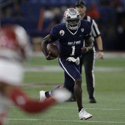 West quarterback Tyler Huntley, of Utah, (1) runs during the second half of the East West Shrine football game Saturday, Jan. 18, 2020, in St. Petersburg, Fla.