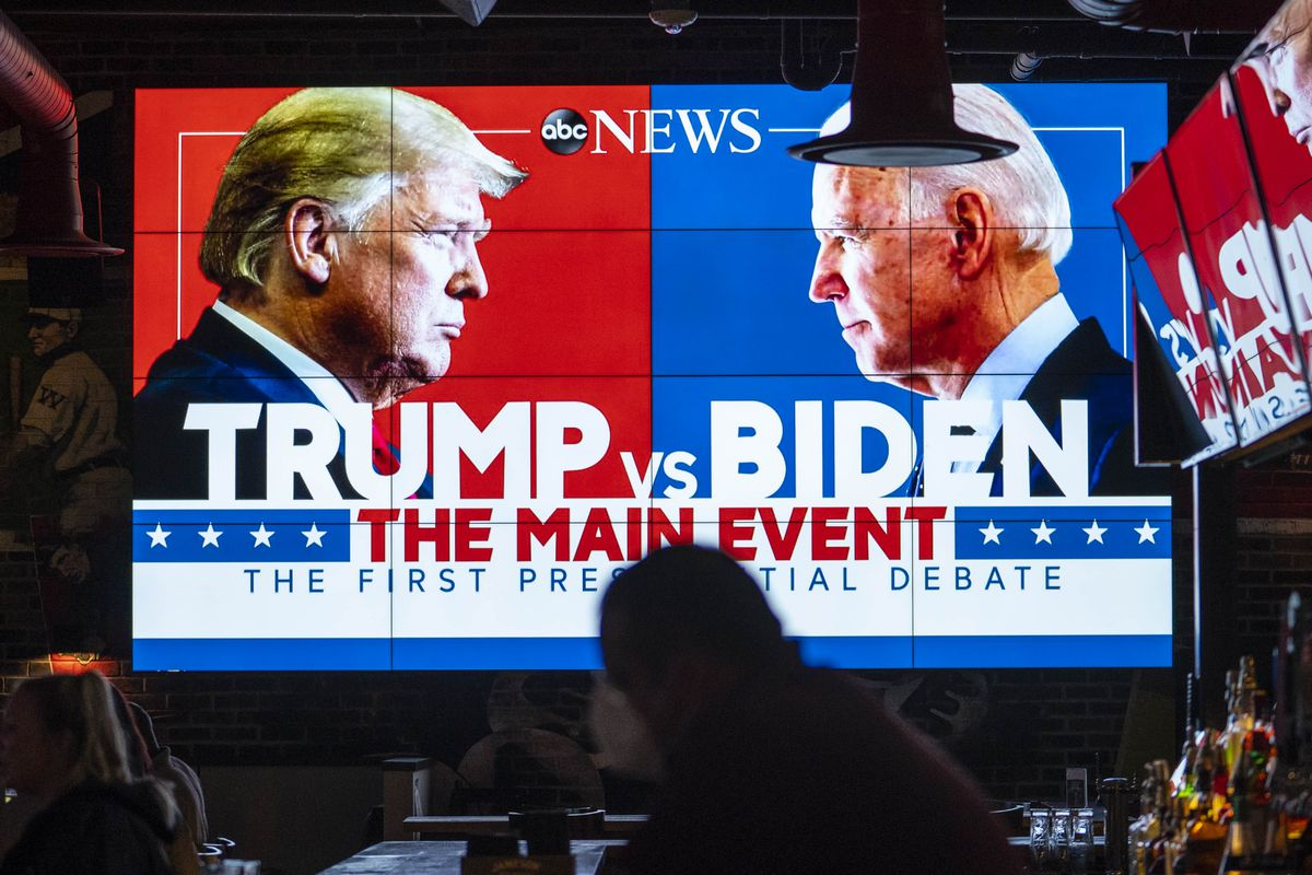 trump vs biden first 2020 presidential debate on TV at a bar