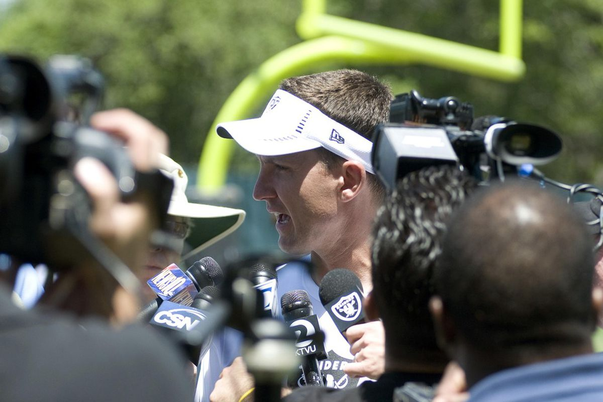 May 12, 2012; Oakland, CA, USA; Oakland Raiders head coach Dennis Allen is interviewed after rookie minicamp at the Raiders practice facility.  Mandatory Credit: Ed Szczepanski-US PRESSWIRE