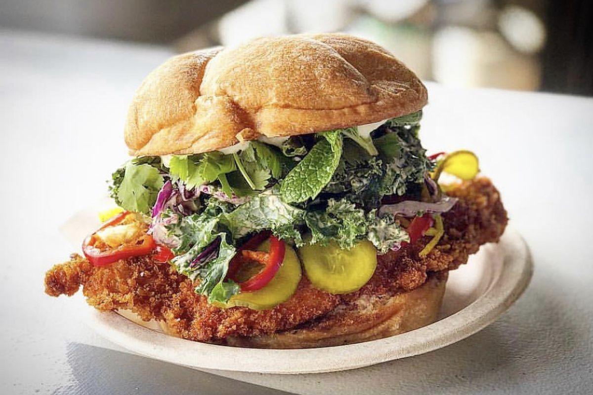 A crispy fried chicken sandwich on a crusty bun.
