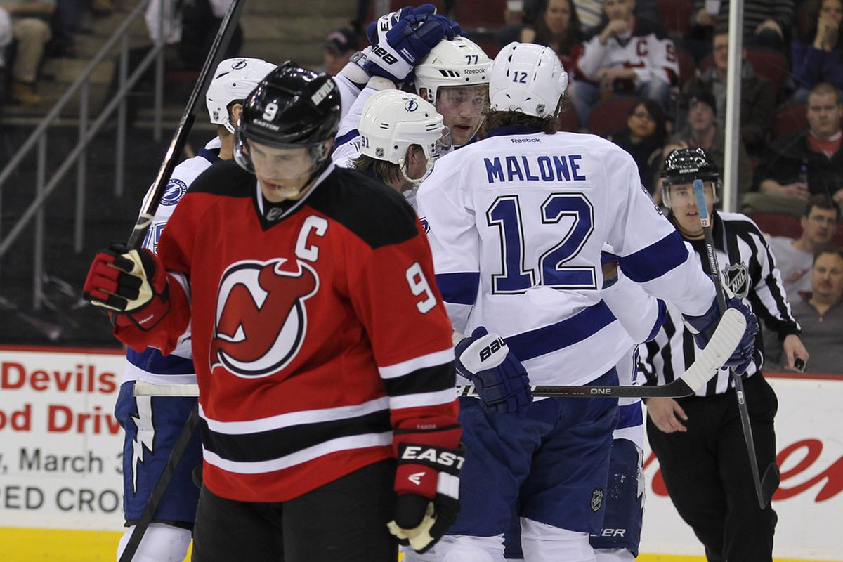Mar 29; Newark, NJ, USA; Tampa Bay Lightning left wing Ryan Malone (12) celebrates his 3rd goal of the game during the second period of their game against the New Jersey Devils at the Prudential Center. Mandatory Credit: Ed Mulholland-US PRESSWIRE