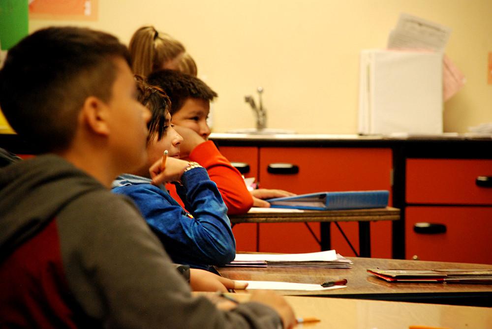 Students at Mrachek Middle School listen to their math teacher.