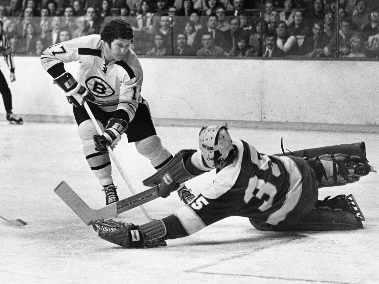 Boston Bruins' Fred Stanfield breaks in on goal against the Minnesota North Stars during an NHL hockey game in Boston in 1973. Stanfield, the mild-mannered sidekick to Bobby Orr on the high-scoring Bruins teams of the early 1970s, has died. He was 77.