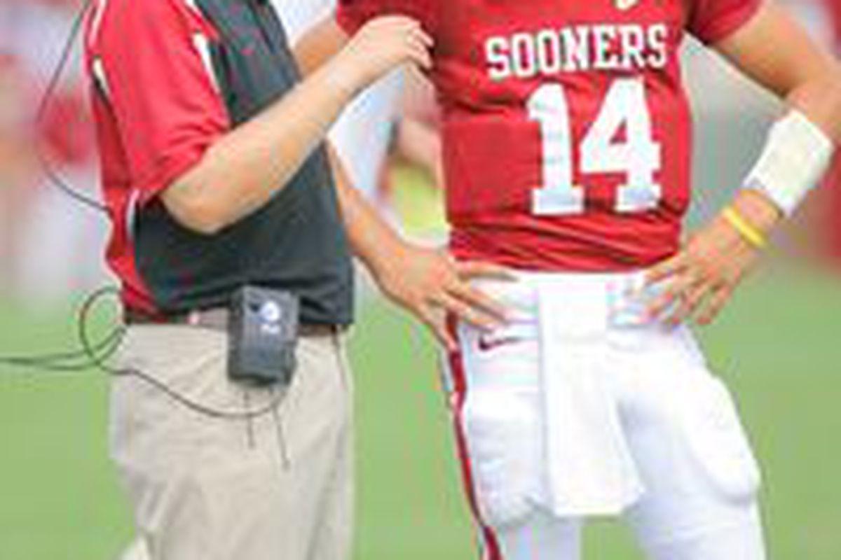 "Josh Heupel has managed to always get the best out of his quarterbacks. Image via <a href=""http://a.espncdn.com/photo/2010/0813/ncf_i_bradford_heupel1x_200.jpg"">ESPN</a>."