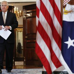 Secretary of State Rex Tillerson walks in to a news conference to speak about Qatar at the State Department in Washington, Friday June 9, 2017. Tillerson is calling on Saudi Arabia, Egypt, the United Arab Emirates and Bahrain to immediately ease their blockade on Qatar.