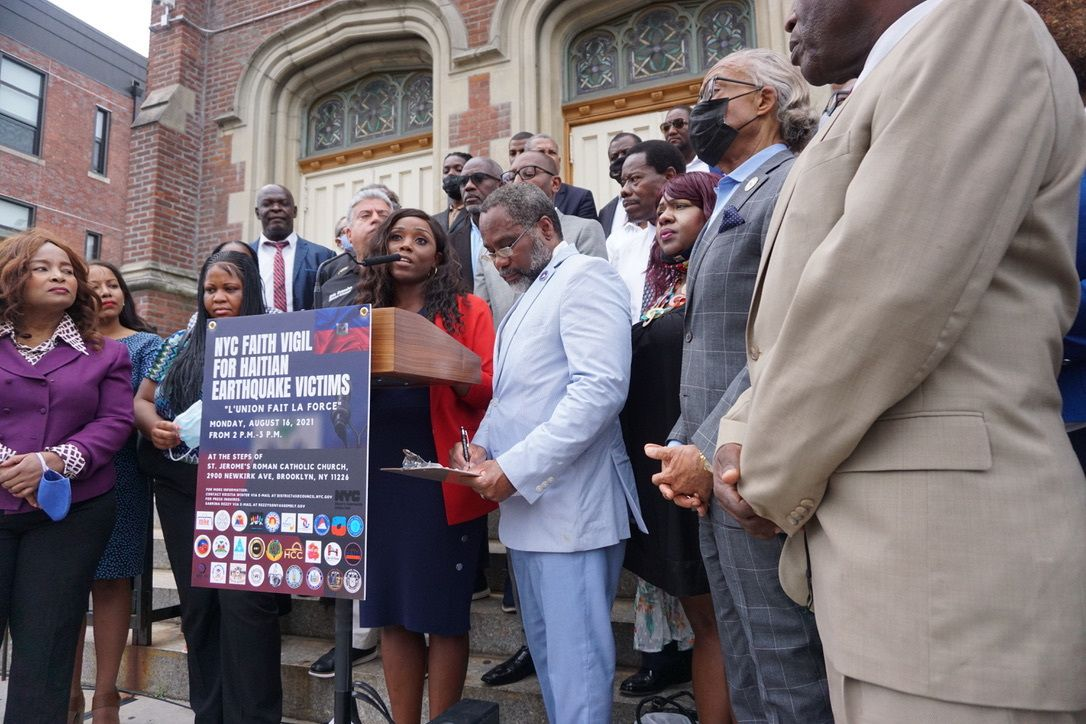 Councilmember Farah Louis, Jackson Rockingster, and Rev. Al Sharpton were among activists and politicians at a rally for Haiti in front of Saint Jerome's Roman Catholic Church in Flatbush, Brooklyn, Aug. 16, 2021.