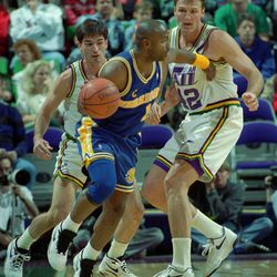 John Stockton and Tom Chambers double team Tim Hardaway. PHOTO BY GARY MCKELLAR. (Submission date: 10/09/2002)