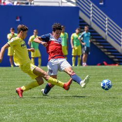 Johan Gomez (9) pressuring Villarreal during the opening match of the 40th Annual Dallas Cup.