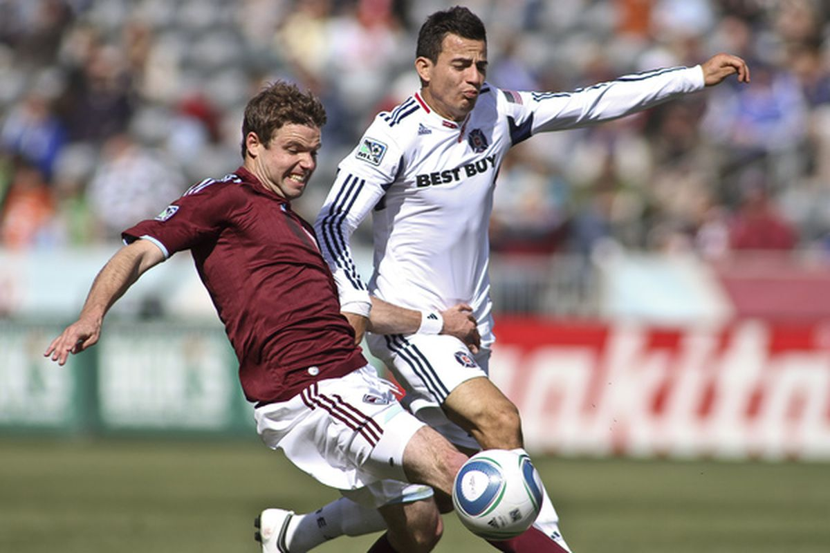 Drew Moor #3 of the Colorado Rapids fights Marco Pappa #16 of the Chicago Fire for control of a loose ball during the second half of the MLS soccer match at Dick's Sporting Goods Park in Commerce City, Colorado. (Photo by Marc Piscotty/Getty Images)