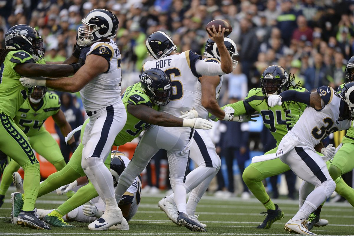 Seattle Seahawks DT Quinton Jefferson hits Los Angeles Rams QB Jared Goff during a Week 5 game, Oct. 3, 2019.