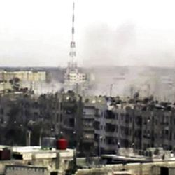 In this image made from amateur video released by the Shaam News Network and accessed Sunday, April 15, 2012, smoke rises from buildings across the city following purported shelling in Homs, Syria. Syrian troops are reported to have shelled residential neighborhoods dominated by rebels in the central city of Homs Sunday, activists said, killing at least three people hours before the first batch of United Nations observers were to arrive in Damascus to shore up a shaky truce.