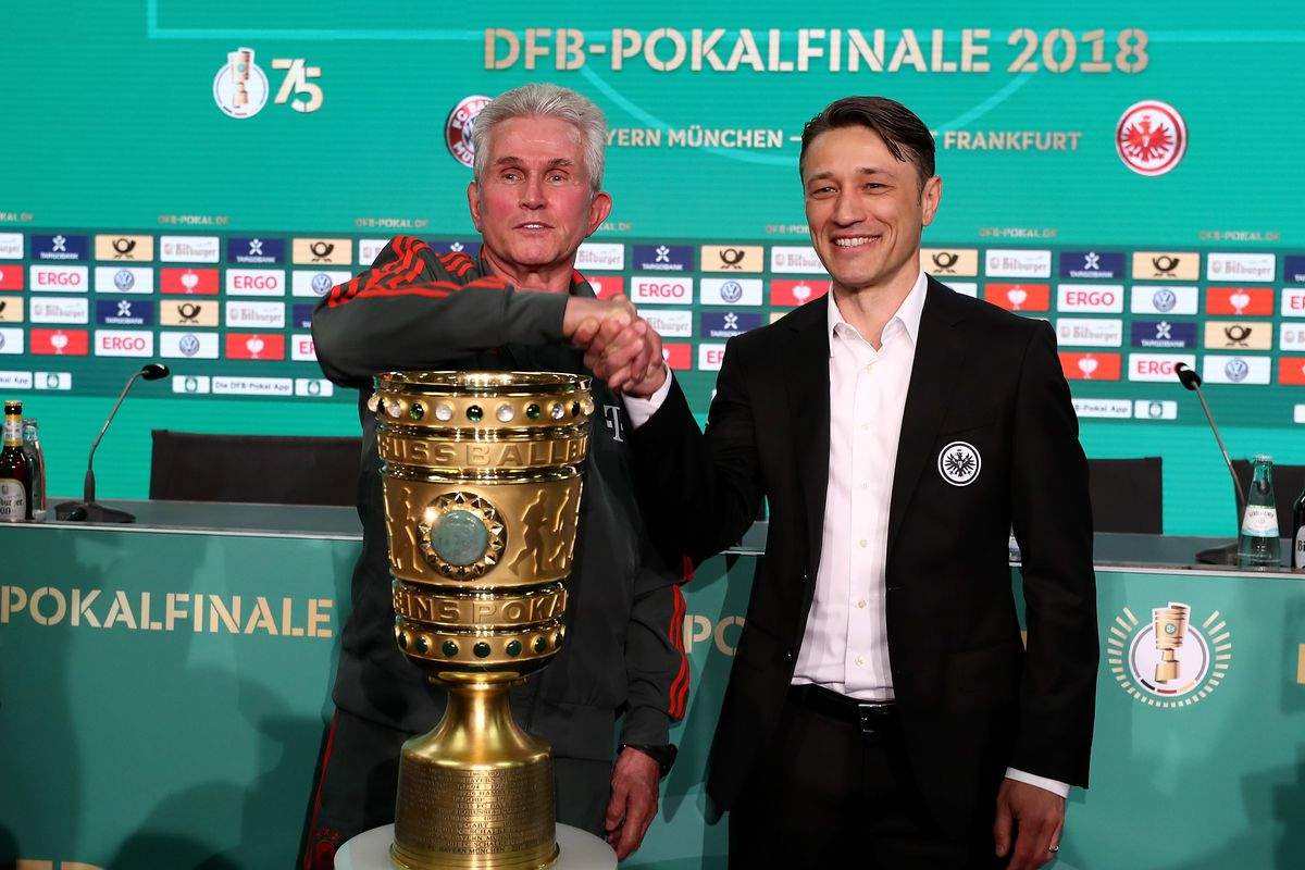 BERLIN, GERMANY - MAY 18: Head coach of Bayern Muenchen Josef Heynckes and head coach of Eintracht Frankfurt Niko Kovac and (L-R) pose with the DFB Cup trophy after the DFB Cup Final Press Conference at Olympiastadion on May 18, 2018 in Berlin, Germany.