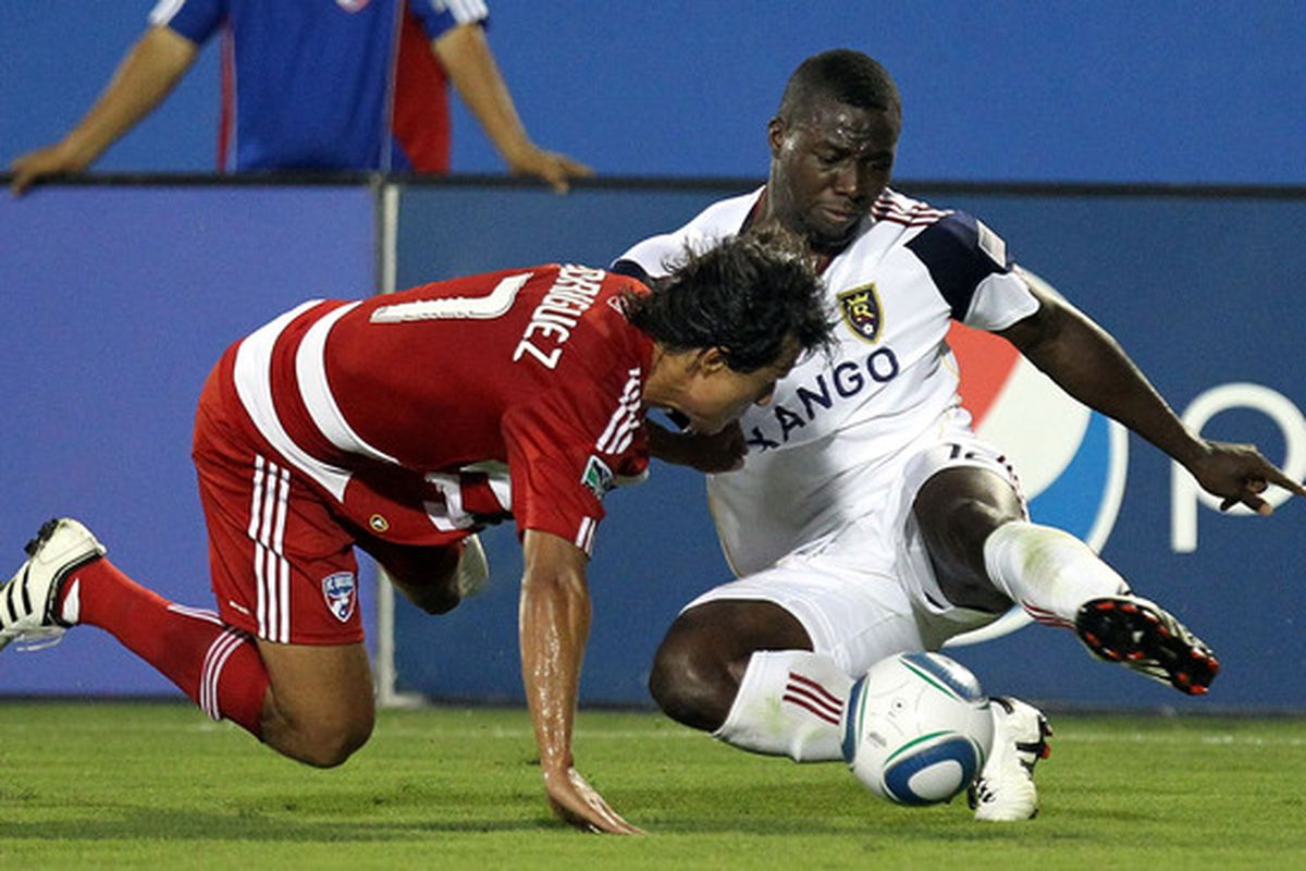 FRISCO TX - JULY 17:  Midfielder Jean Alexandre #12 of Real Salt Lake dribbles the ball against Milton Rodriguez #7 of FC Dallas at Pizza Hut Park on July 17 2010 in Frisco Texas.  (Photo by Ronald Martinez/Getty Images)