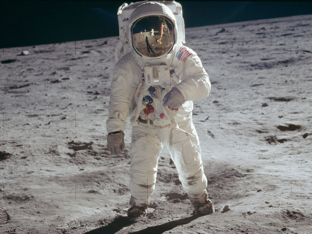 Buzz Aldrin looks at Neil Armstrong during the first moon landing.