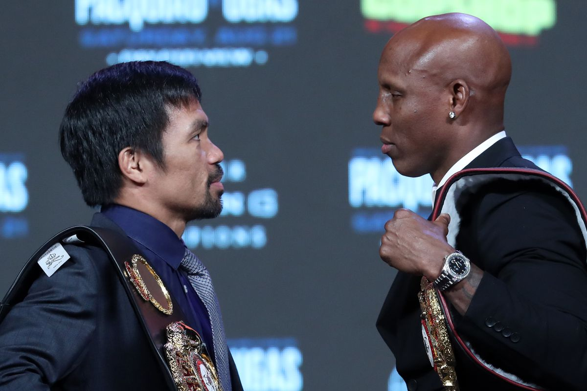 Manny Pacquiao and WBA welterweight champion Yordenis Ugas face off during a news conference at MGM Grand Garden Arena on August 18, 2021 in Las Vegas, Nevada.