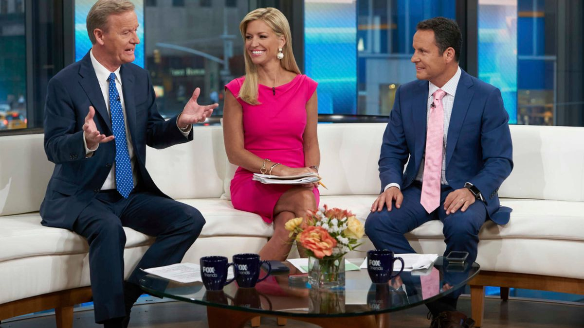 """Steve Doocy, left, co-host of """"Fox & Friends,"""" left, is pictured on the Fox News Channel in 2021."""