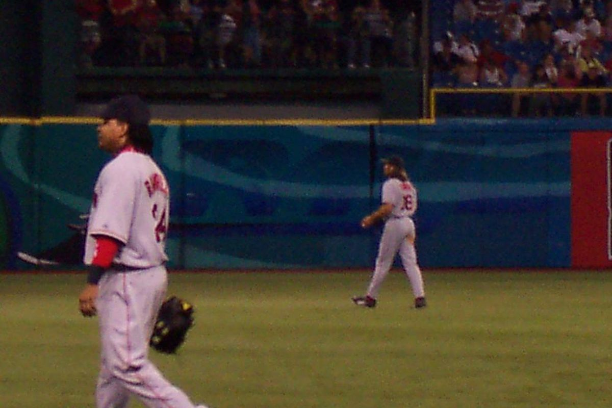 Johnny Damon and Manny Ramirez won a World Series playing together for division rival the Boston Red Sox.
