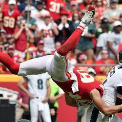 Kansas City Chiefs defensive back Daniel Sorensen (49) leaps as he attempts to tackle Philadelphia Eagles quarterback Carson Wentz (11) during the second half of an NFL football game in Kansas City, Mo., Sunday, Sept. 17, 2017. (AP Photo/Ed Zurga)