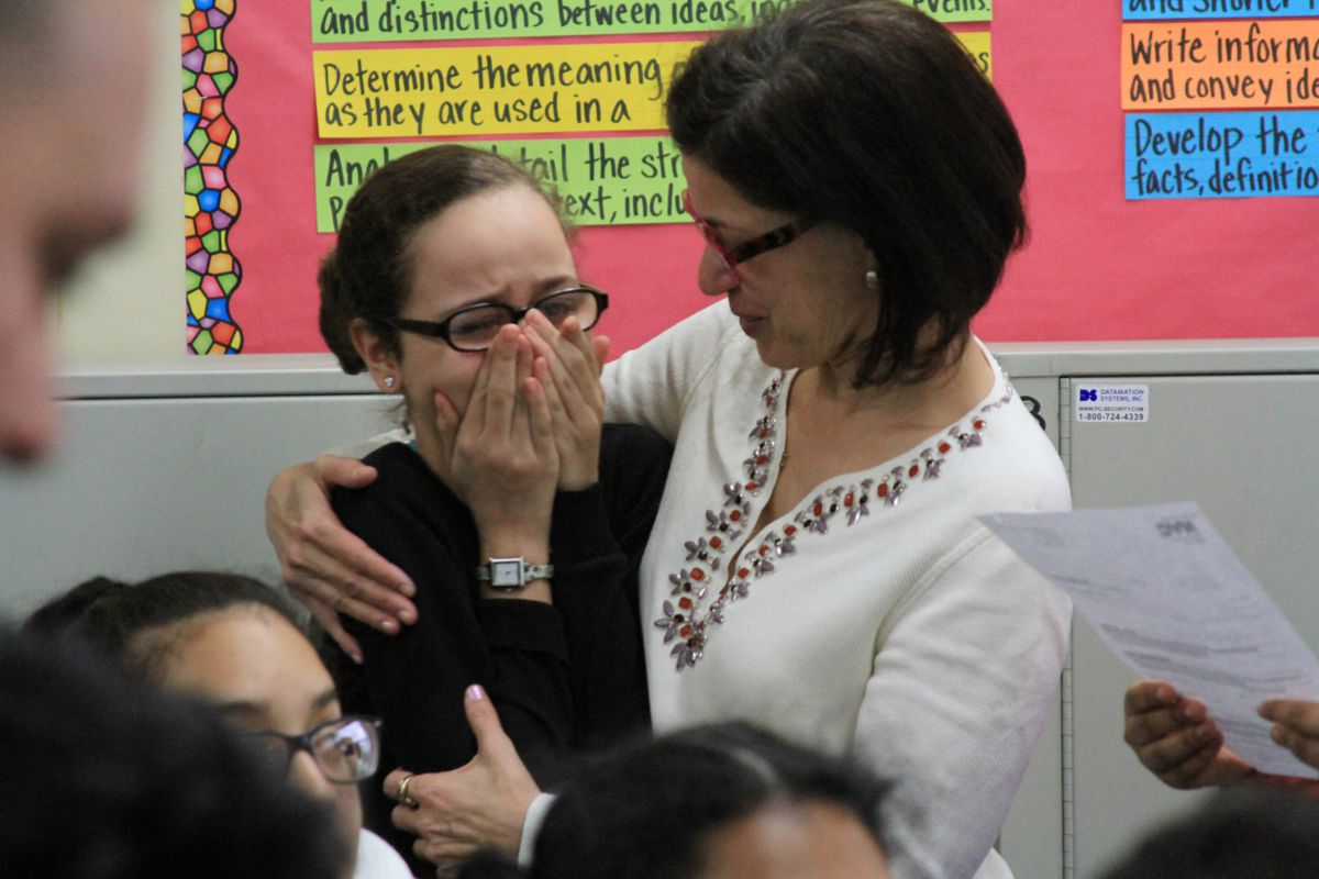 Mariam Djaballah (left), an eighth-grader at M.S. 244, reacts to being admitted into the Beacon School.