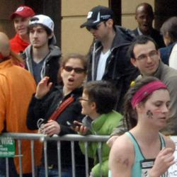 This Monday, April 15, 2013 photo provided by Bob Leonard shows third from left, Tamerlan Tsarnaev, who was dubbed Suspect No. 1 and second from left, Dzhokhar A. Tsarnaev, who was dubbed Suspect No. 2 in the Boston Marathon bombings by law enforcement.  This image was taken approximately 10-20 minutes before the blast.