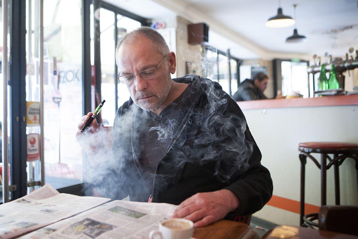 Smoking an e-cigarette in public.