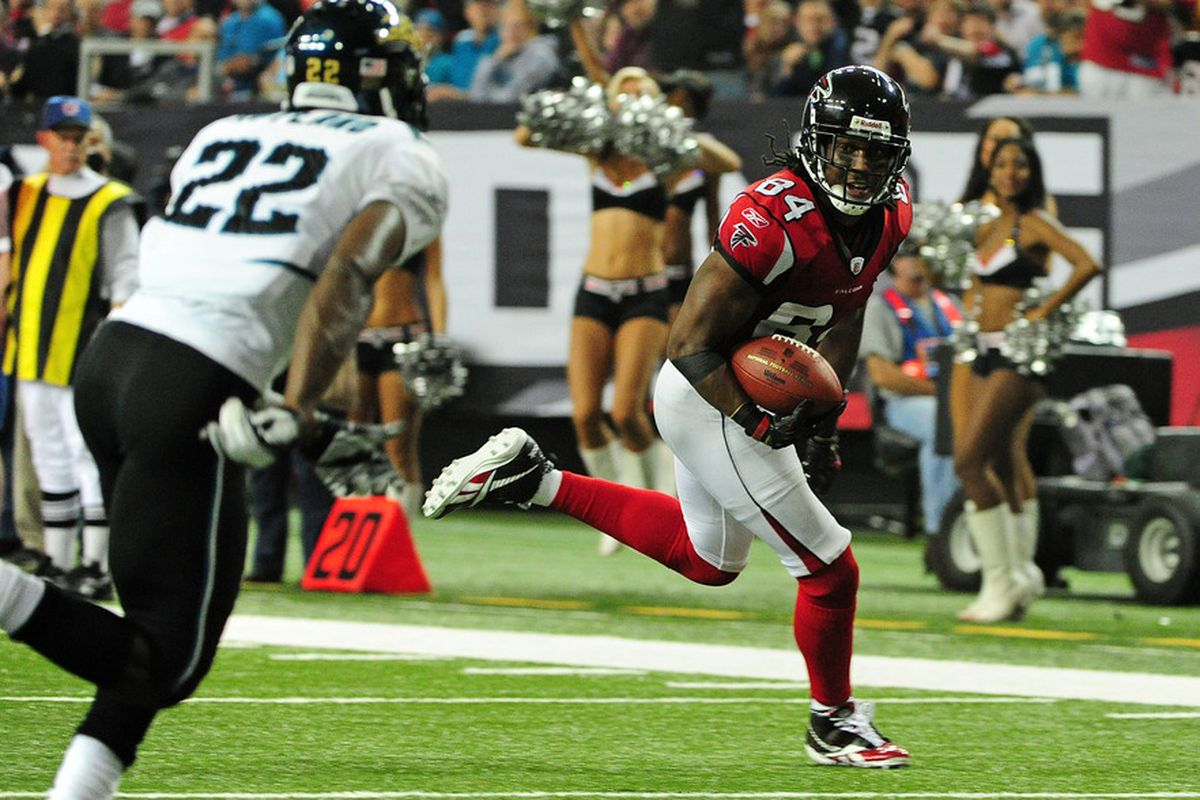 ATLANTA, GA - DECEMBER 15: Roddy White #84 of the Atlanta Falcons runs with a catch for a touchdown against the Jacksonville Jaguars at the Georgia Dome on December 15, 2011 in Atlanta, Georgia. (Photo by Scott Cunningham/Getty Images)