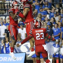 Utah defensive back Terel Burgess (26) and linebacker Francis Bernard (13) celebrate a pickup from Bernard during the first half of the football game at Utah-BYU at LaVell Edwards Stadium in Provo on Thursday, August 29, 2019.